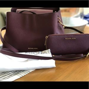 Burgundy Michael Kors purse and wallet